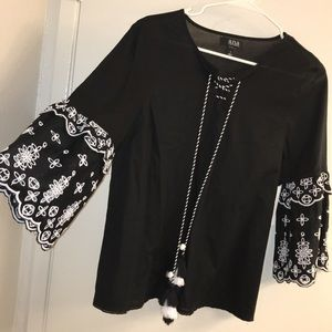 Black bell sleeved top with floral detail